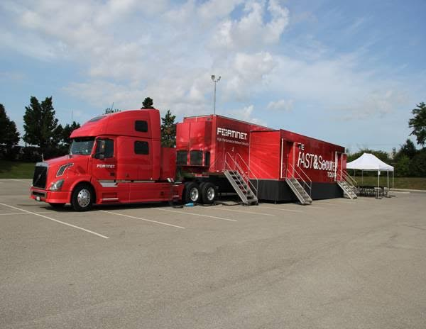 Image of Fortinet Truck with Canopy Tent.jpg.jpeg