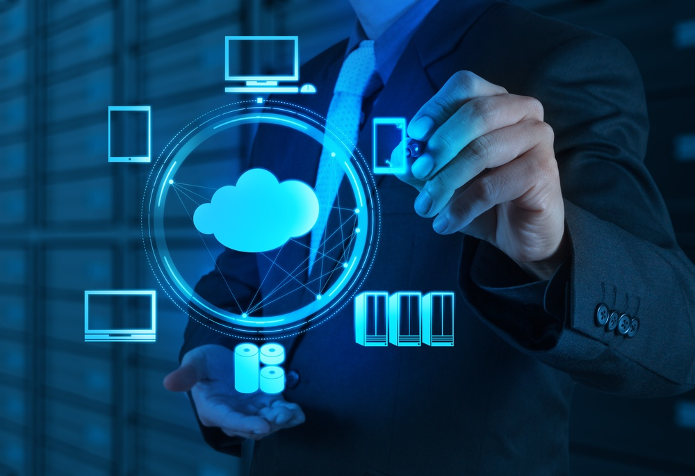 Businessman working with a Cloud Computing diagram on the new computer interface.jpeg